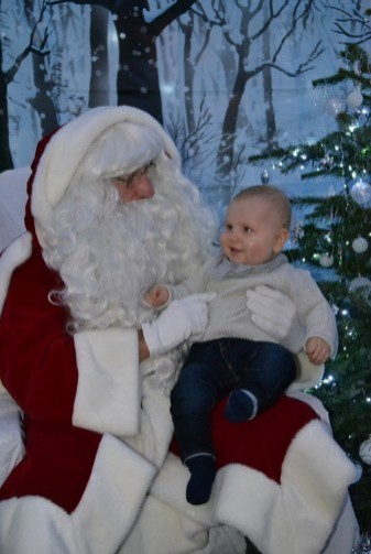 Father Christmas welcomes his first visitor